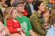 parents and children in the audience at a public event