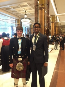 Student with representative at the USLS Symposium
