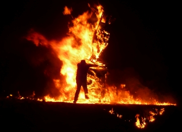 Silhouette of man in flames at Burning of the Clavie