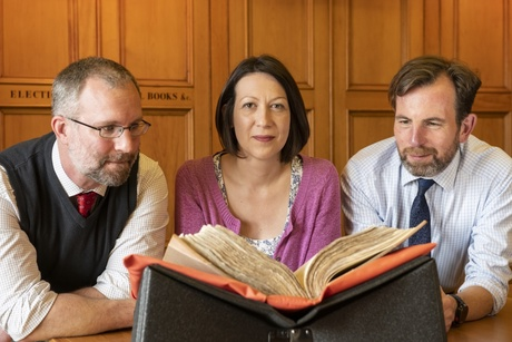 Dr Jackson Armstrong, Dr Claire Hawes and Phil Astley with the Burgh Records