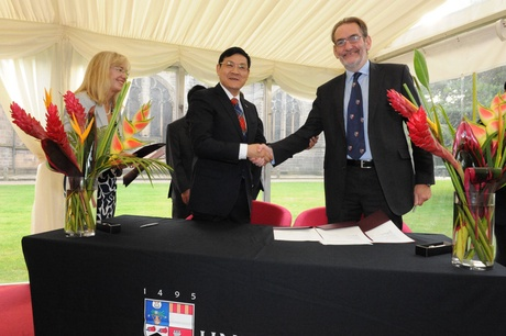 Prof Diamond signs the agreement with Prof Li Xiaohong, President of Wuhan University