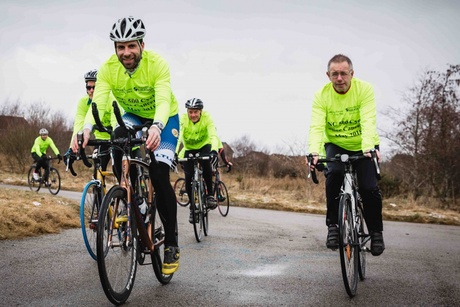 Mark Beaumont, Professor Steve Heys and some of the North Coast 500 'See Cancer' team