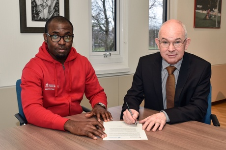 Student President Lawson Ogubie and Principal Professor George Boyne at the signing of the joint initiative