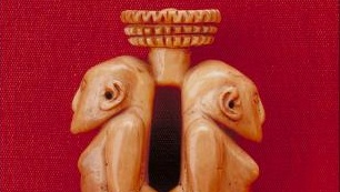 Carved ivory pendant, in the form of two human figures, back to back, from a village in Viti Levu, Fiji