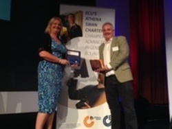 Amanda Lee and Peter Murchie receiving the Athena SWAN Bronze award