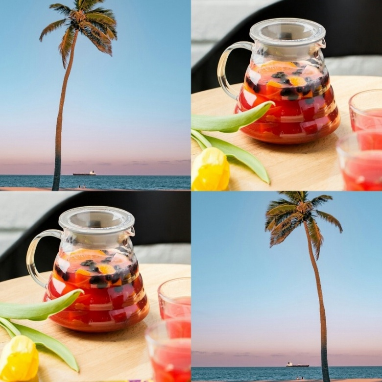 A jug of fruity peach iced tea with palm trees in the background