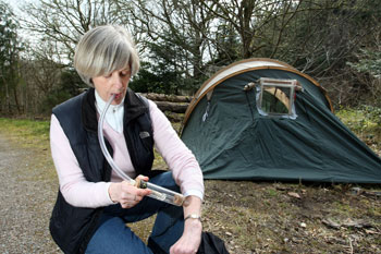Professor Jenny Mordue catches midges with electrocuter in tent window and directly from her arm