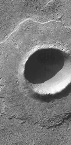 Image that is analogous to what has been discovered - the lobe-like deposit round the Martian crater has been emplaced through the exact same processes as the deposit on the NW coast. Image courtesy of NASA.