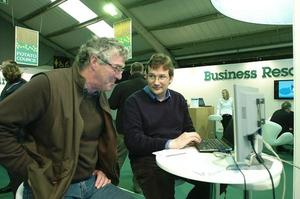 Dr Jon Hillier (right) demonstrates the Cool Farm Tool to a farmer
