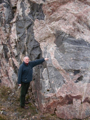 Professor Parnell examining a rock face with granite