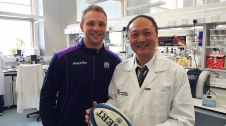 Scotland Rugby player Greig Tonks with Dr Wenlong Huang of the University of Aberdeen
