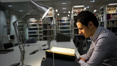 Student studying in Sir Duncan Rice Library