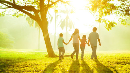Healthy family walking in the park