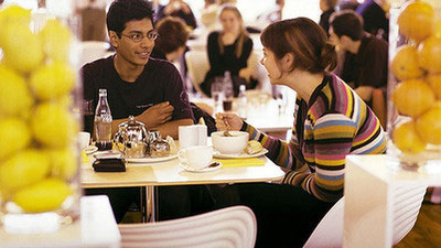 Students talking in a cafe