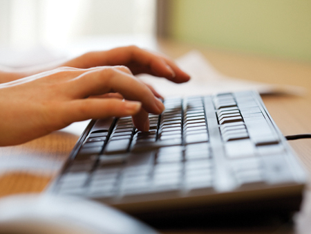 Picture of typing at keyboard
