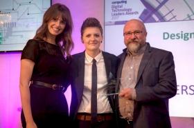 Host Ellie Taylor presents the Design Team of the Year award to Zee Allison and Colin Denholm<br />(Image: www.computing.co.uk)