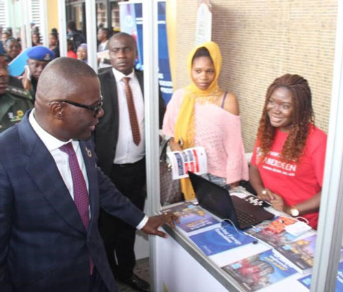 In-Country Officer Blessing Egbe, chatting with the Governor of Lagos State, His Excellency Babajide Sanwo-Olu druing the October 2019 International Week in the University of Lagos, Nigeria.