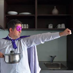 A chef wearing a superhero costume